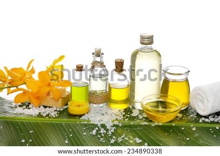 Spa setting and green leaf with pile of salt - stock photo