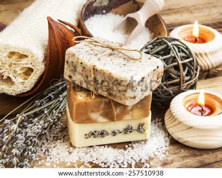 Spa Setting.Homemade Natural Soaps with Coffee, Honey and Lavender, Burning Candles - stock photo