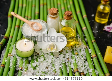 Spa setting on ,bamboo grove, l on black background - stock photo