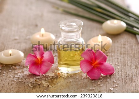 spa setting on board with pile of white salt - stock photo