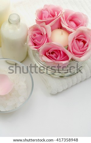 Spa setting on towel - stock photo