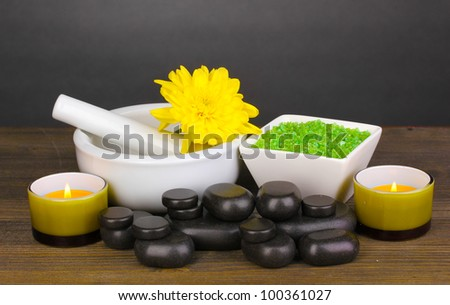 Spa setting on wooden table on grey background