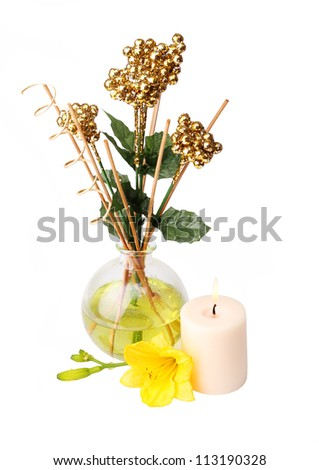 spa setting with aroma sticks, candle, and flower isolated on white - stock photo