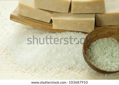 spa setting with bath salts on wooden