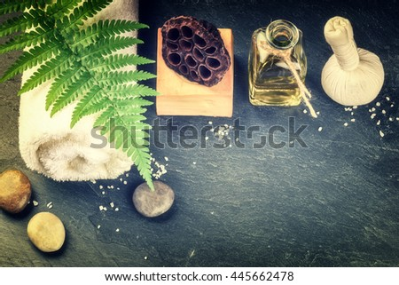 Spa setting with beauty treatment accessories - essential oil, herbal ball and soap bar. Wellness concept, top view - stock photo