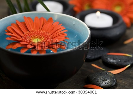 Spa setting with bowl of water, flower and candles. SPA concept - stock photo