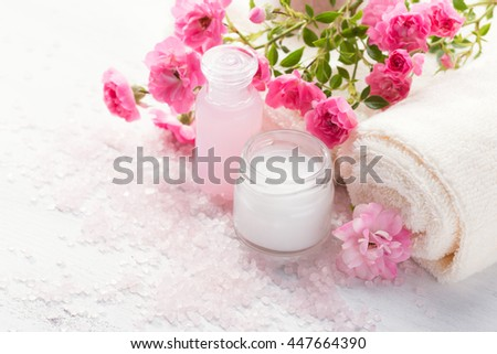 Spa setting with   branch of  small  pink roses.  Selective focus - stock photo