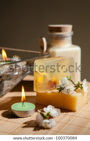 Spa setting with candle, flower, and natural soap