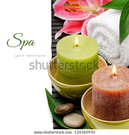 Spa setting with candles and lily isolated over white - stock photo