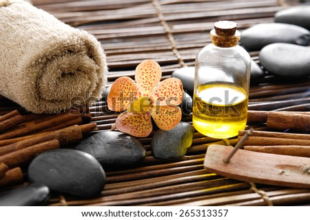 Spa setting with cinnamon on mat