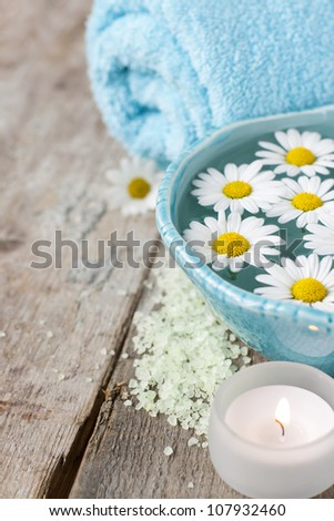 Spa setting with daisies - stock photo