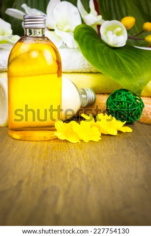 Spa setting with essential oil on wooden background  - stock photo