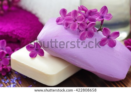 SPA setting with flowers soap and fresh lilac flowers - stock photo