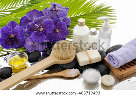 Spa setting with green palm ,purple orchid