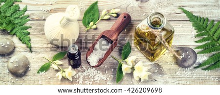Spa setting with jasmine essential oil and flowers. Wellness concept, top view  - stock photo