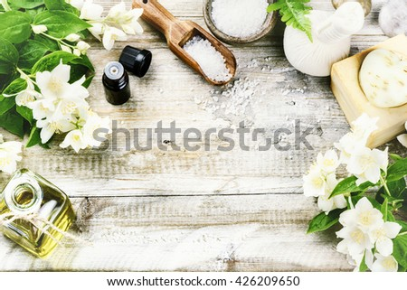 Spa setting with jasmine flowers and essential oil. Wellness concept, top view  - stock photo