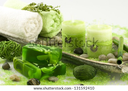 spa setting with natural soap and bath towels