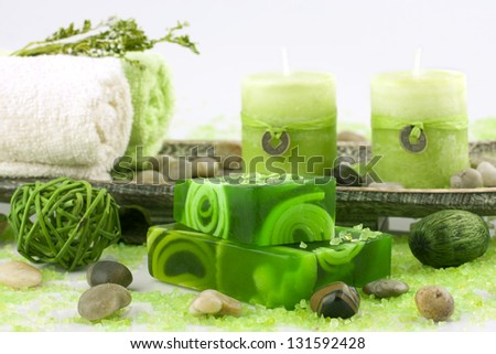 spa setting with natural soap and bath towels - stock photo