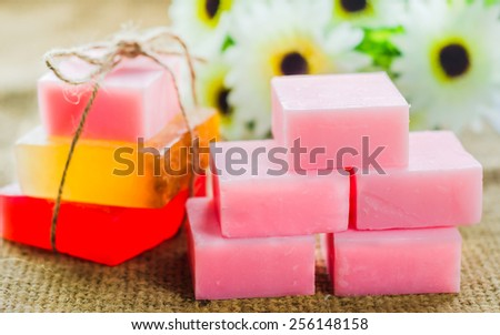 Spa setting with natural soaps and  flower. for aromatherapy. - stock photo