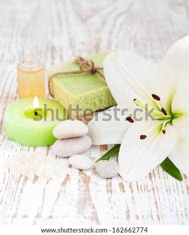 Spa setting with natural soaps, lily  flower and  candle