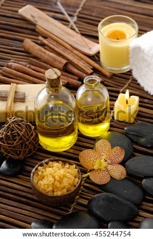 Spa setting with orchid. cinnamon on mat - stock photo