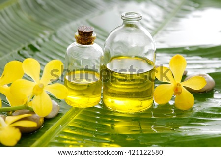 spa setting with pebbles ,oil, orchid and banana leaf - stock photo