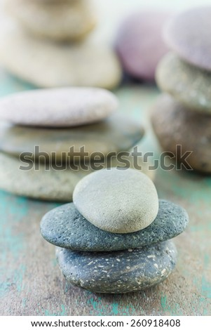 Spa setting with spa stones on wooden background