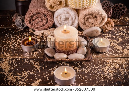 Spa setting with towels and candles - stock photo