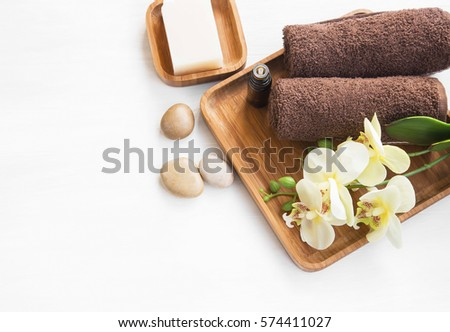 Spa setting with towels , orchid flower, soap and massage stones, overhead shot