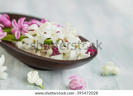 Spa setting with white and pink hyacinth flowers - stock photo