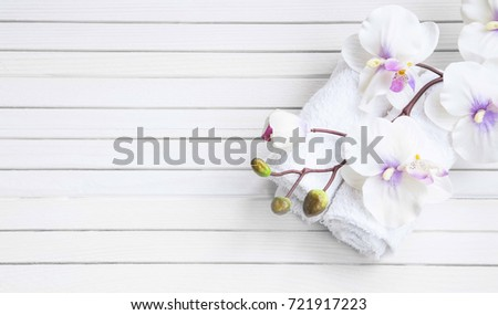 SPA setting with white orchid flower and bath towels, overhead shot