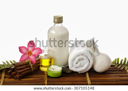 Spa setting with with ,towel, grove, oil, candle on mat - stock photo
