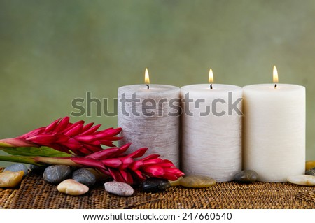 Spa Settings with three candle on mat - stock photo