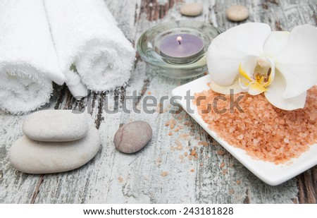 spa still life - a flower and towels on a wooden background - stock photo