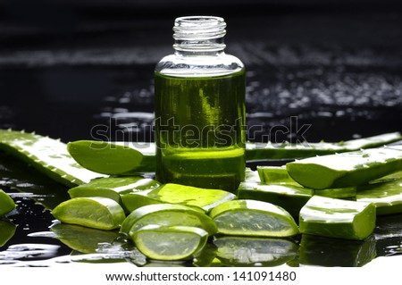 Spa still life- aloe with lotion - stock photo