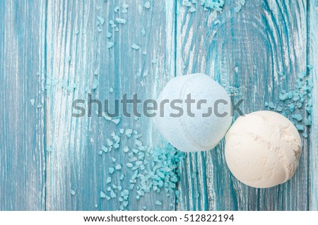 SPA still life, closeup of blue bath bombs on wooden background. Flat lay with space for text