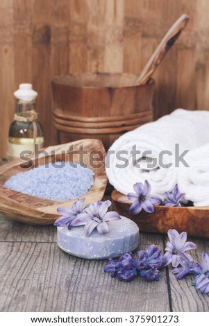 Spa still life. Natural body care products, hyacinth,  soap, oil, bath salt. Macro selective focus with retro style processing, blank space