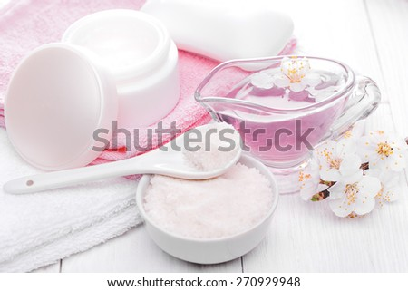 Spa still life of sea salt and essential oils and apricot flowers