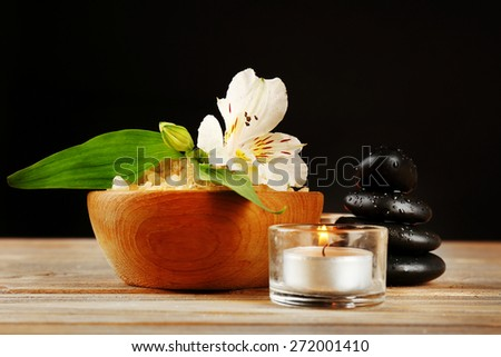 Spa still life on wooden table on black background - stock photo