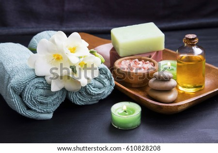 Spa still life, treatments products with flower, towels, oil salt , soap and candles