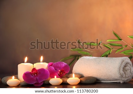 Spa Still life with aromatic candle orchid flower and towel - stock photo