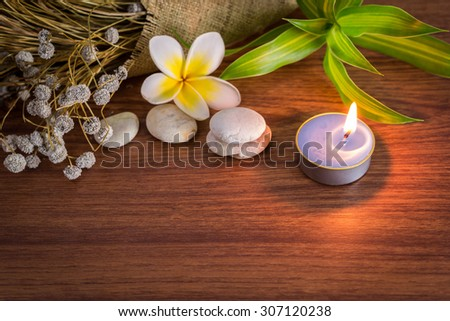 Spa still life with aromatic candles,Frangipani flowers and towel
