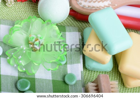 Spa still life with aromatic candles, sea salt, stones, hair brush, flower and towel Relax and treatment therapy. Summer season.  - stock photo