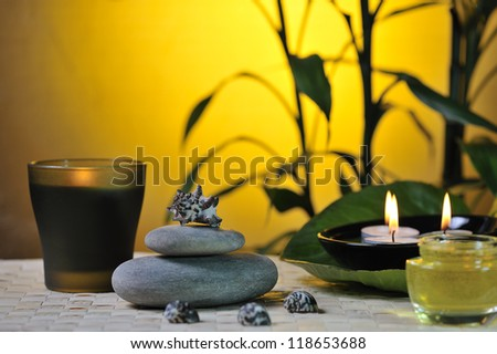 spa still life with bamboo on glowing yellow background