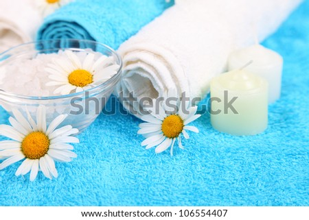 Spa still life with blue towels, flowers, salt and towels