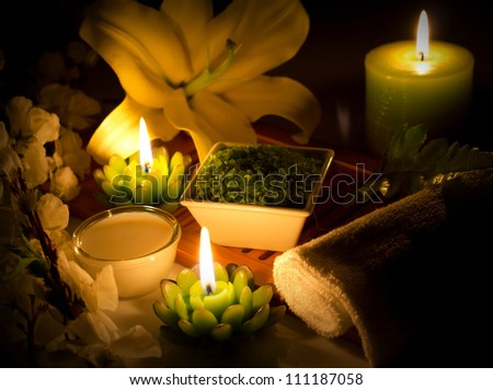 spa still-life with candles, cosmetics, flowers - stock photo