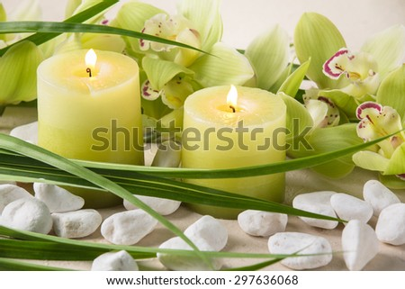 Spa still life with candles,pebble stones and orchid - stock photo