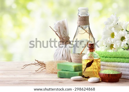 Spa still life with essential oil, salt, and towel - stock photo