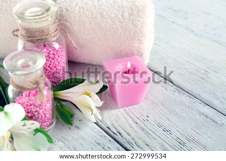 Spa still life with flower and candle on wooden table, closeup - stock photo