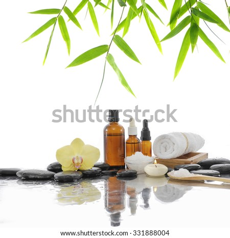 Spa still life with forchid ,towel and black stone,candle - stock photo